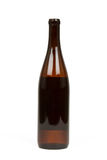 Brown Bottle of Alcohol Stock Photography
