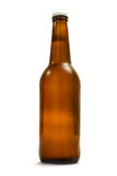 Brown bottle with beer Stock Images