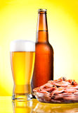 Brown bottle of beer with a condensate Royalty Free Stock Photos