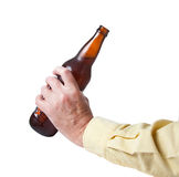 Brown bottle of beer in old hand. Brown bottle of cold beer being prepared for drinking stock photos