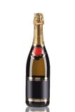 Brown bottle of champagne with golden top. Stock Photo