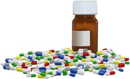 Brown bottle with colored pills around Stock Photo