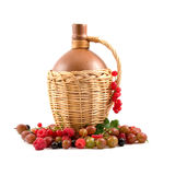 Brown bottle and fresh berries Royalty Free Stock Photography