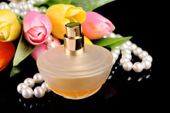 Brown bottle of parfume Stock Images