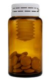 a brown bottle with pills Royalty Free Stock Photo