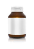 Brown bottle with white label Stock Images