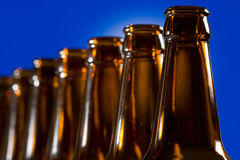 Brown bottles on blue background Stock Images