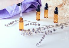 Brown bottles of essential oil with dry lavender stock photos