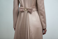 Brown bow on back of women brown coat Royalty Free Stock Images