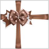 Brown bow with crosswise ribbons Royalty Free Stock Photography