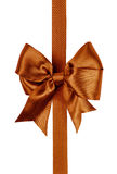 Brown bow made from silk ribbon Stock Images