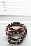 Brown bow tie belt. Grooms wedding morning. Close up of modern man accessories Stock Photos