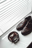 Brown bow tie, leather shoes and belt. Grooms wedding morning. Close up of modern man accessories Royalty Free Stock Photos