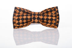 Brown bow tie on a white background Stock Photo