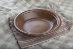 Brown bowl Stock Images