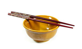 Brown bowl ceramic and chopsticks isolated. Royalty Free Stock Image
