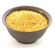 Brown bowl with couscous on white background Stock Photos