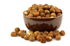Brown bowl with fresh hazelnuts Royalty Free Stock Photos