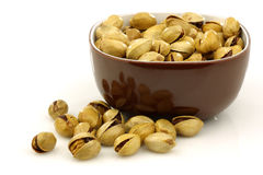Brown bowl with pistachio nuts Royalty Free Stock Photography