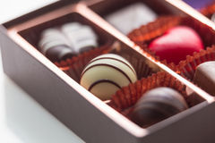 Brown Box of Chocolate with Assorted Chocolates, macro Stock Photography