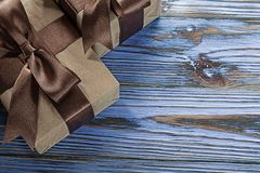 Brown boxed gifts on vintage wooden board.  royalty free stock photo