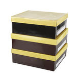 Brown boxes with yellow lids Stock Photos