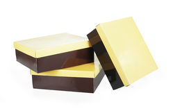 Brown boxes with yellow lids Royalty Free Stock Photos