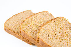 Brown bread. Three pieces of brown bread on white Stock Images