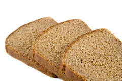 Brown bread. Three pieces of brown bread on white Stock Photos