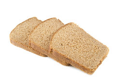 Brown bread. Three pieces of brown bread on white Royalty Free Stock Photo