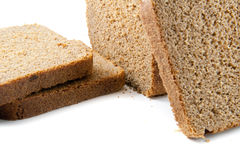 Brown bread. Natural cuting brown bread on white Royalty Free Stock Image