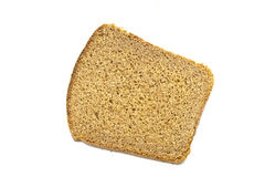 Brown bread. One piece of brown bread on white Royalty Free Stock Image