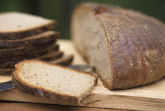 Brown bread. On a chopping board Royalty Free Stock Photography