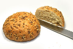 Brown bread. Close-up with dark grain seed bread and grains Royalty Free Stock Image