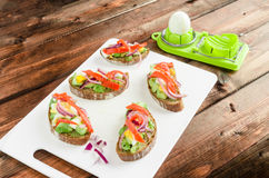 Brown bread with avocado, smoked salmon, boiled egg Stock Images