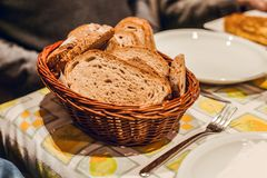 Brown bread basket on table stock photos