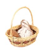 Brown bread in basket. Brown bread in wicker basket. Isolated on a white background Stock Photography
