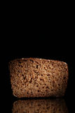 Brown bread on a black background with reflection Royalty Free Stock Photo
