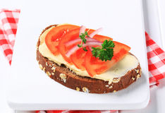 Brown bread with butter and tomato Royalty Free Stock Photos