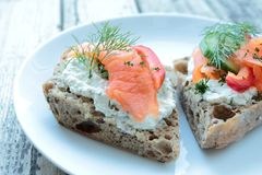 Brown bread with cheese and salmon Royalty Free Stock Images