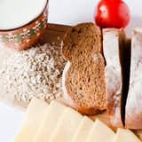 Brown bread with cheese, tomatoes and milk Royalty Free Stock Photos