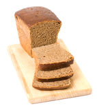 Brown bread on cutting board Royalty Free Stock Photos