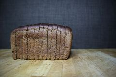 Brown bread on a dark background royalty free stock image