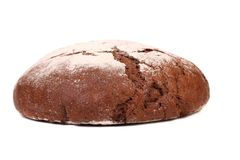 Brown bread dusted the flour. Stock Image