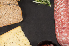 Brown bread, dutch gouda cheese and meat on slate board Stock Image