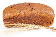 Brown bread with ears of wheat Stock Photos
