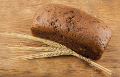 Brown bread with ears of wheat Stock Photography