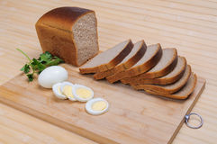 Brown bread and egg Stock Photography