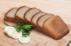 Brown bread and egg Royalty Free Stock Images