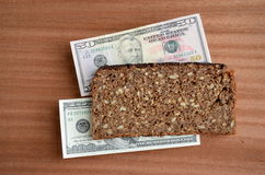 Brown bread food and money concept Stock Photos